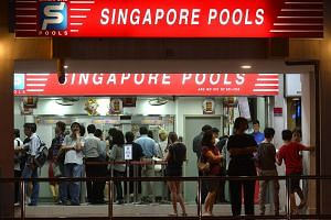 Crowd at a Singapore Pools outlet.