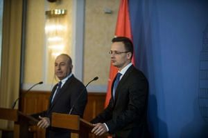 Turkish Foreign Minister Mevlut Cavusoglu (left) and his Hungarian counterpart Peter Szijjarto hold a press conference on Feb 9, 2016.