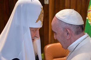 Pope Francis (right) and the head of the Russian Orthodox Church, Patriarch Kirill, greet each other during a historic meeting in Havana on Feb 12, 2016.