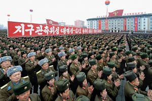 North Korean people and soldiers celebrating a report on the recent rocket launch in Pyongyang on Feb 8.