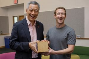 Facebook founder Mark Zuckerberg presented PM Lee with an artwork etched with lines from a computer program he wrote when they met at the social network's headquarters in Menlo Park on Feb 12.