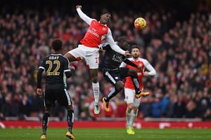 Arsenal's Danny Welbeck (centre) in action during their match against Leicester City on Feb 14, 2016.