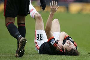 Manchester United's Matteo Darmian down injured.