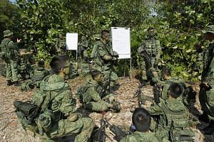Full-time National Service specialist cadets before a training exercise near Pasir Laba Camp, on July 1, 2013.