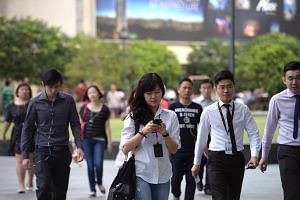 Office workers at Raffles Place on Feb 18, 2015.