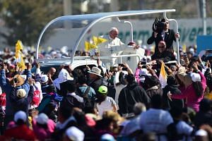 Pope Francis waves from the popemobile upon arrival in San Cristobal de las Casas, in Chiapas, for his second open-air mass, on Feb 15, 2016.