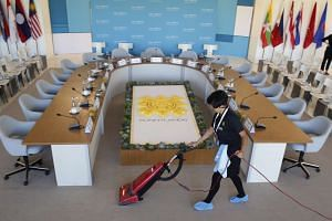 A worker vacuums the meeting room ahead of the Association of Southeast Asian Nations (ASEAN) summit at Sunnylands, California, on Feb 15, 2016.
