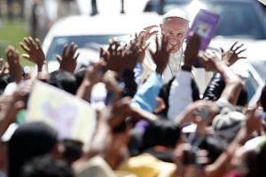 Pope Francis waves to the crowd after celebrating a Mass at San Cristobal de las Casas, Mexico on Feb 15, 2016.