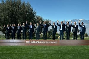 US President Barack Obama and PM Lee Hsien Loong along with other Asean leaders wave while a group photograph is being taken at the Sunnylands meeting.