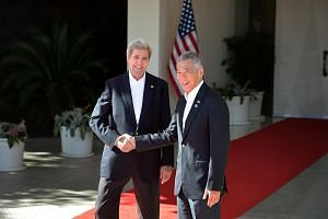 PM Lee Hsien Loong (right) with US Secretary of State John Kerry during the US-Asean leaders summit.