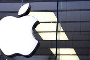An Apple logo is seen at the Apple store in Munich, Germany.
