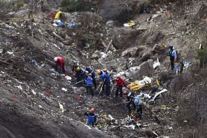 Gendarmes and investigators work on March 26, 2015 in the scattered debris on the crash site of the Germanwings Airbus A320.
