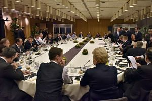 EU heads of state and government participate in a round table meeting at an EU summit in Brussels, Belgium, Feb 19 2016.
