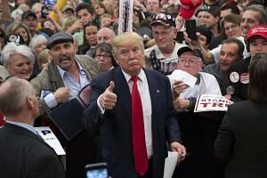 Trump gestures to photographers at a rally Feb 19, 2016, in Myrtle Beach, South Carolina.