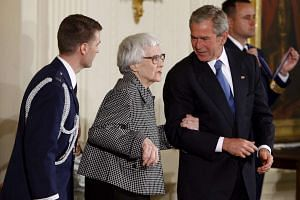 George W. Bush (right) accompanies Harper Lee (centre) at the Presidential Medal of Freedom ceremony in 2007.