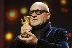 Director Gianfranco Rosi receives the Golden Bear for his movie Fuocoammare (Fire at Sea).