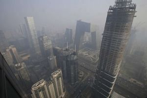 Buildings are pictured amid the smog in Beijing's central business district, on Dec 21, 2015.