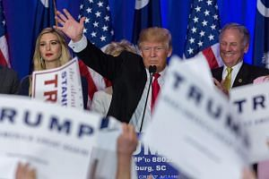 Republican Presidential candidate Donald Trump acknowledges cheering supporters on Feb 20, 2016.
