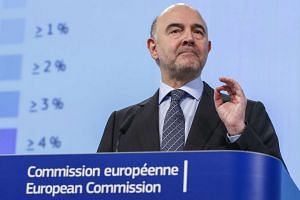 European Commissioner for Economic and Financial Affairs Pierre Moscovici presents the EU executive's winter economic forecasts during a news conference at the EU Commission headquarters in Brussels, Belgium on Feb 4, 2016.