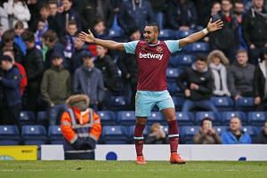 Dimitri Payet celebrates scoring the fifth goal for West Ham,