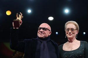 Meryl Streep (right) poses with the winner of the Golden Bear for Best Film, Gianfranco Rosi for Fuocoammare (Fire at Sea)during the Closing and Awards Ceremony of the 66th annual Berlin International Film Festival.