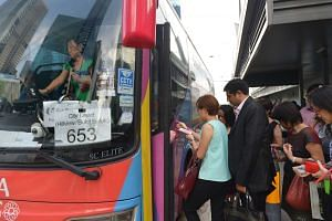 Passengers boarding City Direct bus service 653, which plies a route between the CBD and Hillview/Bukit Batok.