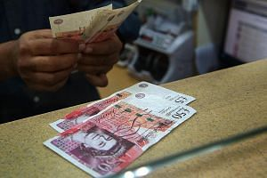The Singdollar hovered at around 1.98 to the British pound yesterday, close to Monday's two-year low. The prospect of Britain's exit from the EU has sparked concern in financial markets and the wider business community, causing the pound plunge. Anal