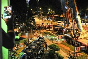 The mobile crane being removed from the crash site at 2.18am, on Feb 25, 2016.