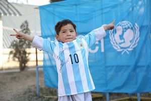 Murtaza posing in his shirt, signed by Messi, in Kabul, Afghanistan, Feb 25 2016.