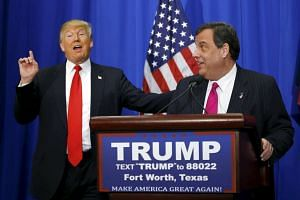 US Republican presidential candidate Donald Trump (left) speaks next to New Jersey Governor Chris Christie at a campaign rally where Christie endorsed Trump's candidacy for president, in Fort Worth, Texas on Feb 26, 2016.