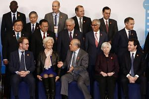 Officials taking their positions for a group photo at the G-20 Finance Ministers and Central Bank Governors Meeting in Shanghai on Feb 27, 2016.