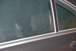 Madonna and her entourage leave the CIP terminal.