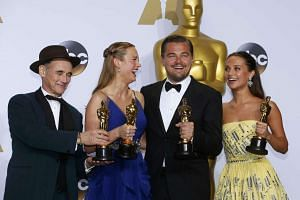 Leonardo Di Caprio (third from far left), finally taking his Best Actor Oscar, in a message on climate change. With him are (from far left) Best Supporting Actor winner Mark Rylance, Best Actress Brie Larson and Best Supporting Actress Alicia Vikande