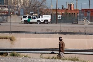 A man looking at Border Patrol vehicles parked in El Paso, Texas, as seen from Ciudad Juarez, Mexico, on Feb 24, 2016.