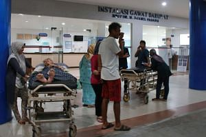 Indonesian patients and relatives gather outside a hospital in Padang late on the night of March 2, 2016, after a 7.8-magnitude earthquake struck off Sumatra's west coast.