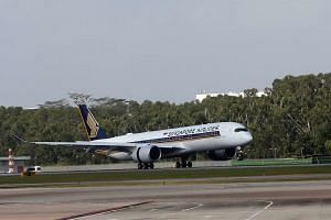 Singapore Airlines' first Airbus A350 lands at Changi Airport.
