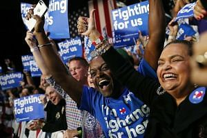 Supporters of Mrs Hillary Clinton at her Super Tuesday gathering in Miami, Florida. Many Democratic voters said they were ready to eschew the dreamy Bernie Sanders revolution for Mrs Clinton as they believe she can save them from a Trump presidency.