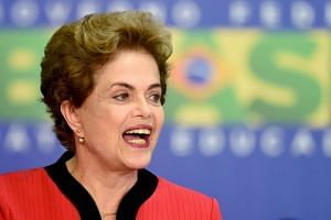 """President Dilma Rousseff said the settlement would help heal """"a tragedy without precedent."""""""