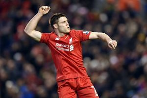 Liverpool's James Milner celebrates scoring the second goal.