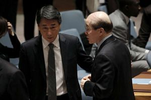 South Korean ambassador Oh Joon (left) speaks to Chinese ambassador Liu Jieyi before the UN meeting.