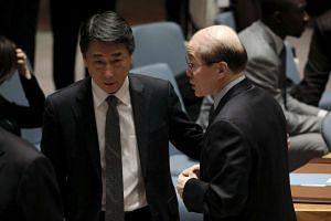 South Korean ambassador Oh Joon (left) speaks to Chinese ambassador Liu Jieyi before the UN meeting.
