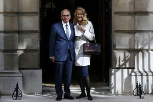Media mogul Rupert Murdoch and Jerry Hall pose for a photograph in London, Britain on March 4, 2016.