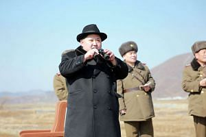 Kim Jong Un inspecting a flight drill in an undated photo released by North Korea on Feb 21.