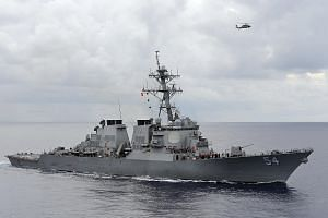 A US Navy guided-missile destroyer patrolling in the Philippine Sea in 2013.
