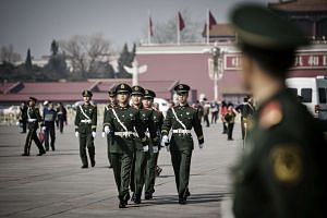 Paramilitary policemen marching through Tiananmen Square in Beijing on March 2.