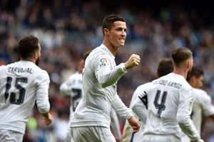 Ronaldo (centre) celebrates after making it a hat-trick by scoring his third goal.