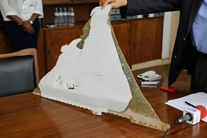 A photo of the piece of aircraft wreckage taken at Mozambique's Civil Aviation Institute in Maputo on March 3, 2016.