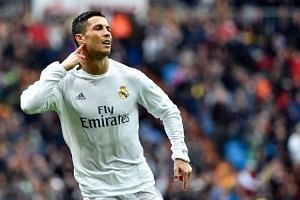 Ronaldo wheeled away in celebration with hand cupped to his ear after smashing home Madrid's second goal.
