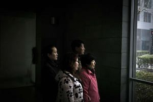 Chinese relatives of passengers lost on board the missing Malaysia Airlines plane awaiting information in Beijing, following news that a piece of aircraft debris had been found off the coast of Mozambique. The news came just before the second anniver