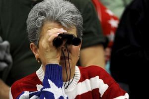 A supporter looks at Donald Trump during a campaign rally in Kansas on March 5, 2016.